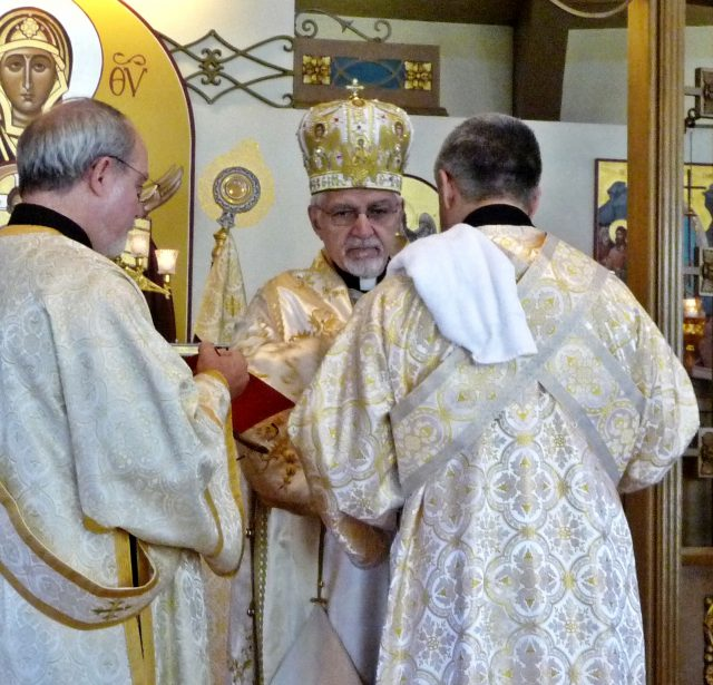 Bishop Nicholas, aided by Deacon Dennis, ordains Rich Bailey as subdeacon at Our Lady of Perpetual Help in Worcester, MA.